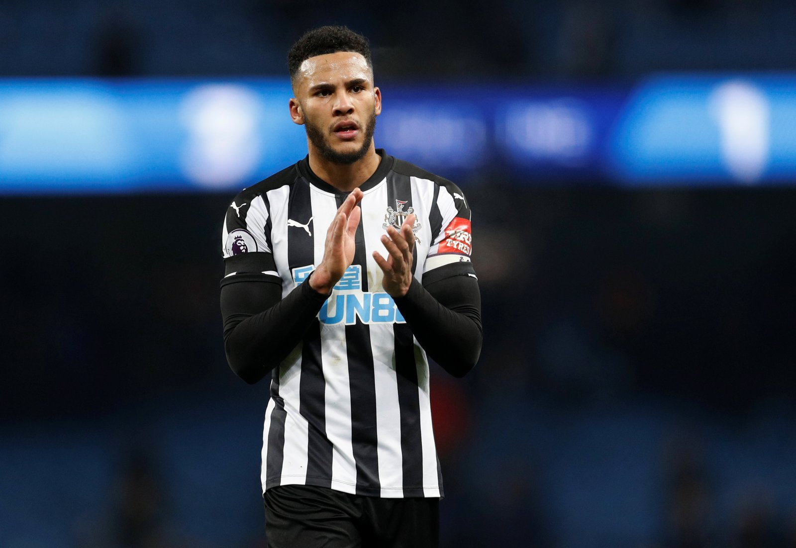 Newcastle's Jamaal Lascelles being watched by scouts