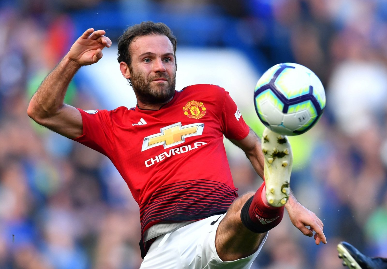 Arsenal move for Juan Mata may help relieve Mesut Ozil of his duties