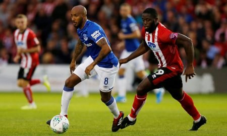 Everton's Fabian Delph in action with Lincoln City's John Akinde