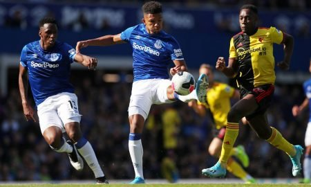 Everton's Mason Holgate and Yerry Mina in action with Watford's Danny Welbeck