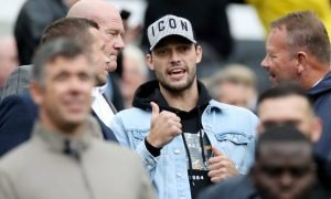 Newcastle United's Andy Carroll in the stands before the Arsenal match