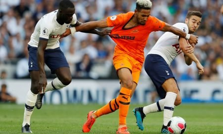 Newcastle United's Joelinton in action with Tottenham Hotspur's Harry Winks and Davinson Sanchez August, 2019