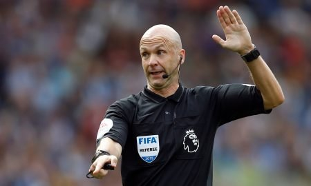 Referee Anthony Taylor gestures v Brighton after disallowing a Leandro Trossard goal after a VAR review, August 2019