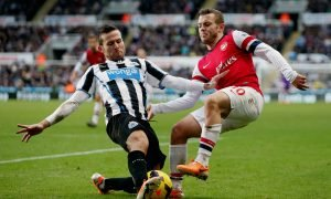 Arsenal's Jack Wilshere (R) in action with Newcastle'e Yohan Cabaye