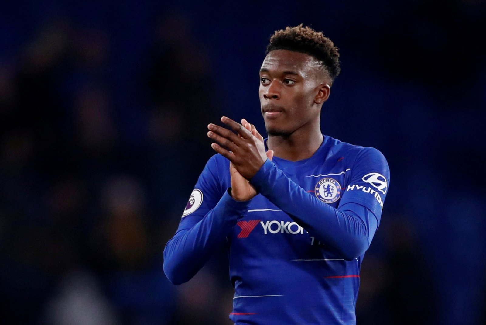 Chelsea's Callum Hudson-Odoi applauds fans after the Brighton match, April 2019