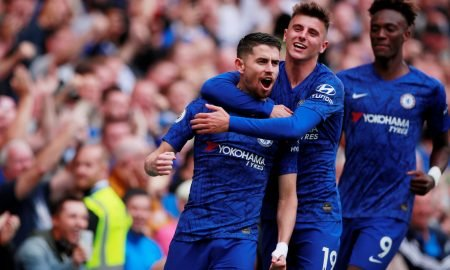 Chelsea's Jorginho celebrates scoring their first goal v Brighton & Hove Albion with teammate Mason Mount