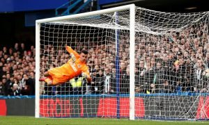 Chelsea's Marcos Alonso scores their third goal as Newcastle United's Karl Darlow attempts save