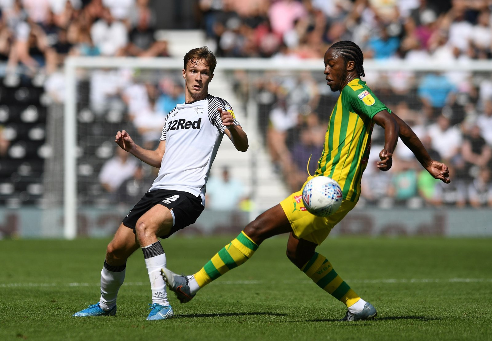 Derby County's Kieran Dowell in action with West Bromwich Albion's Romaine Sawyers