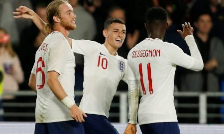 England U21's Phil Foden, Ryan Sessegnon and Tom Davies celebrate at the end of the match