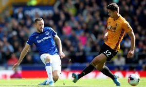 Everton's Gylfi Sigurdsson in action with Wolverhampton Wanderers' Leander Dendoncker