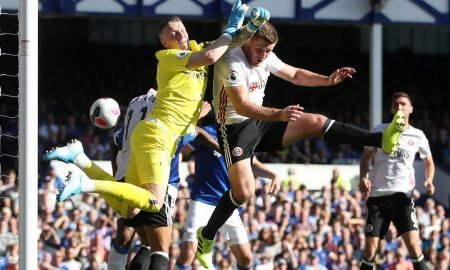 Everton's Jordan Pickford in action with Sheffield United's Jack O'Connell before Everton's Yerry Mina scores an own goal and Sheffield United's first