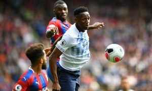 Everton's Yerry Mina in action with Crystal Palace's Christian Benteke and Andros Townsend