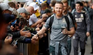 Leeds United's Adam Forshaw interacts with fans after arriving at Elland Road before the Swansea match, Aug 2019