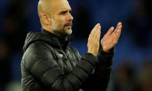 Manchester City manager Pep Guardiola applauds fans after the Everton match