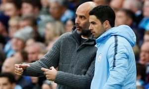 Manchester City manager Pep Guardiola with assistant coach Mikel Arteta