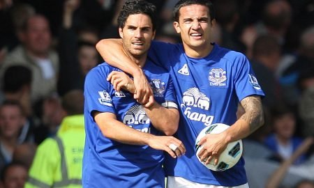 Mikel Arteta (L) celebrates with Tim Cahill after scoring the third goal for Everton