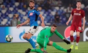 Napoli's Fernando Llorente scores their second goal as Liverpool's Adrian and Andrew Robertson look on - Champions League - Group E - Sep 2019