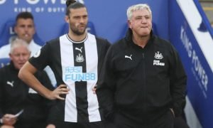 Newcastle United manager Steve Bruce and Andrew Carroll look dejected as the striker prepares to come on at Leicester City