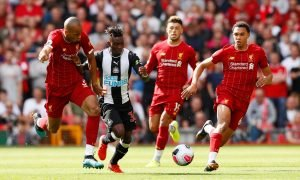 Newcastle United's Christian Atsu in action with Liverpool's Fabinho and Trent Alexander-Arnold