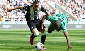 Newcastle United's Miguel Almiron in action with Watford's Christian Kabasele