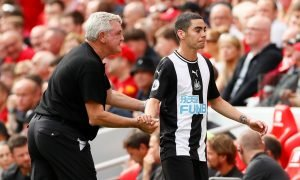Newcastle United's Miguel Almiron with manager Steve Bruce after being substituted