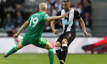 Newcastle United's Paul Dummett in action with Watford's Will Hughes