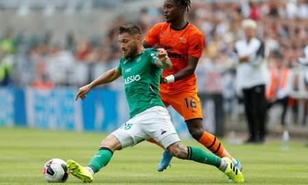 Newcastle United's Rolando Aarons in action with St Etienne's Mathieu Debuchy