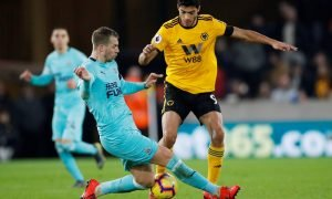 Wolverhampton Wanderers' Raul Jimenez in action with Newcastle United's Florian Lejeune