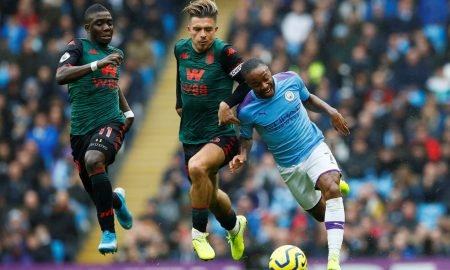 Aston Villa's Jack Grealish and Marvelous Nakamba in action with Manchester City's Raheem Sterling