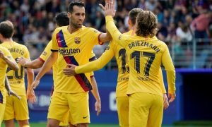 Barcelona's Antoine Griezmann celebrates scoring their first goal against Eibar with Sergio Busquets