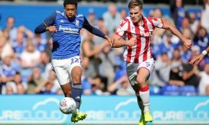 Birmingham City's Jude Bellingham in action with Stoke City's Liam Lindsay
