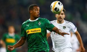 Borussia Moenchengladbach's Alassane Plea in action with Wolfsberger's Michael Novak