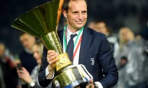 Juventus coach Massimiliano Allegri as he celebrates winning Serie A with the trophy