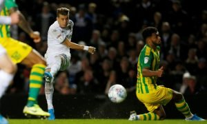 Leeds United's Ezgjan Alioski hits the winning goal against West Bromwich Albion, which is later marked as a Kyle Bartley own goal