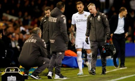 Leeds United's Liam Cooper leaves the pitch after sustaining an injury against West Bromwich Albion