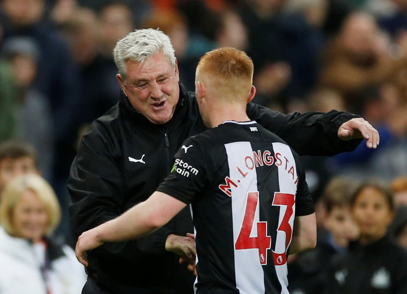 Newcastle United manager Steve Bruce celebrates with Matthew Longstaff after the Manchester United match.JPG