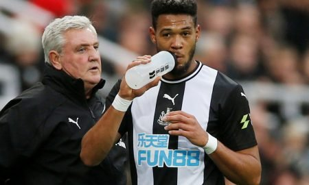 Newcastle United's Joelinton has a drink as manager Steve Bruce looks on v Manchester United
