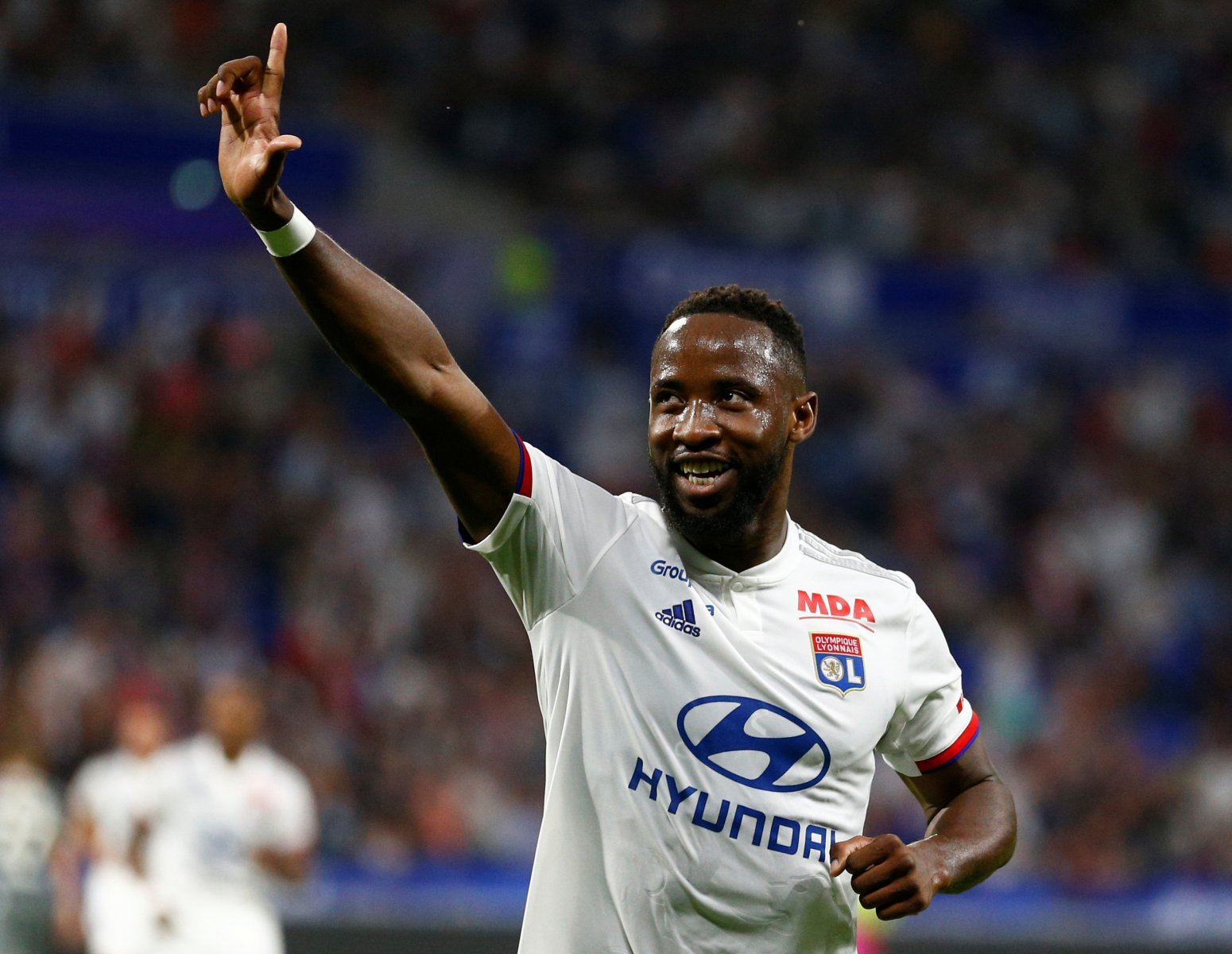 Olympique Lyonnais' Moussa Dembele celebrates scoring their second v Angers