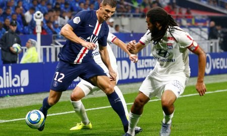 Paris St Germain's Thomas Meunier in action with Olympique Lyonnais' Jason Denayer