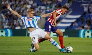 Real Sociedad's Martin Odegaard in action with Atletico Madrid's Marcos Llorente