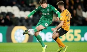 Sheffield Wednesday's Adam Reach in action with Hull City's Brandon Fleming