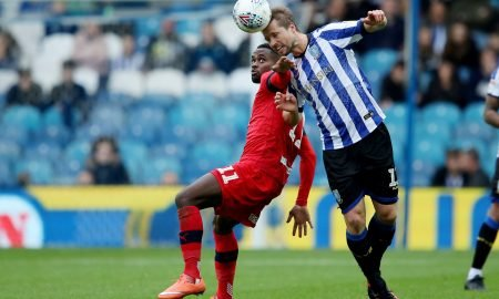 Sheffield Wednesday's Julian Borner in action with Wigan Athletic's Gavin Massey