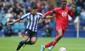 Wigan Athletic's Jamal Lowe in action with Sheffield Wednesday's Massimo Luongo